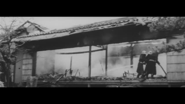 rightwing groups set fire to kono residence/helicopter flying over ichiro kono's residence putting out the fire gasoline cans photographs burned... - 給油点の映像素材/bロール