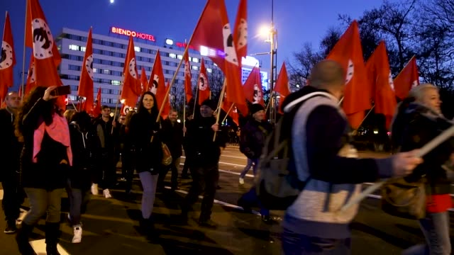 right-wing protesters march carrying satirical banners, flags and signs in mock-support of german chancellor angela merkel on the day she visited the... - satire stock-videos und b-roll-filmmaterial