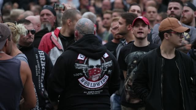 Rightwing supporters shout abuse at nearby heckling leftists at a rightwing protest gathering the day after a man was stabbed and died of his...