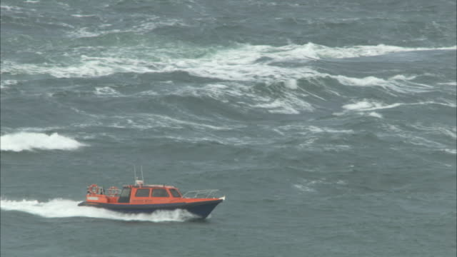 ms rigid inflatable boat in big seas in the hebrides on the west coast of scotland  - hebrides stock videos & royalty-free footage