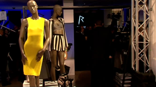 stockvideo's en b-roll-footage met rihanna launches fashion range for river island: rihanna photocall and fashion show; models along at end of show / rihanna appears on stage, blows... - verschijning