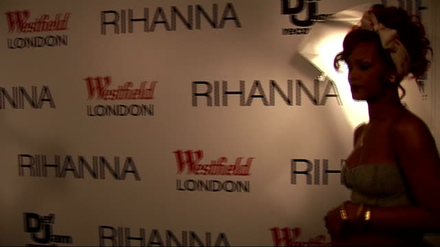 Rihanna switches on Christmas lights at Westfield Shopping Centre **BEWARE Rihanna arriving and posing for photocall on red carpet as screaming fans...