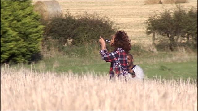 Rihanna told off by farmer during filming of her latest video Long shot Rihanna video shoot in field as Rihanna wearing underwear into shot Rihanna...
