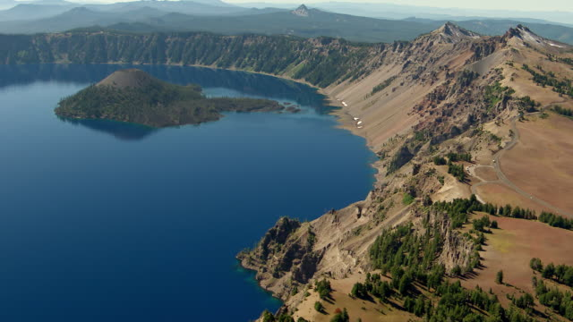 WS AERIAL Rim of crater with jagged peaks at Crater Lake / Oregon, United States