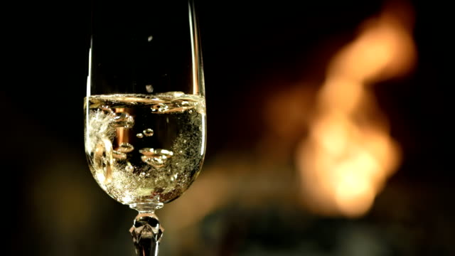 HD SLOW MOTION: Ring In A Glass Of Champagne