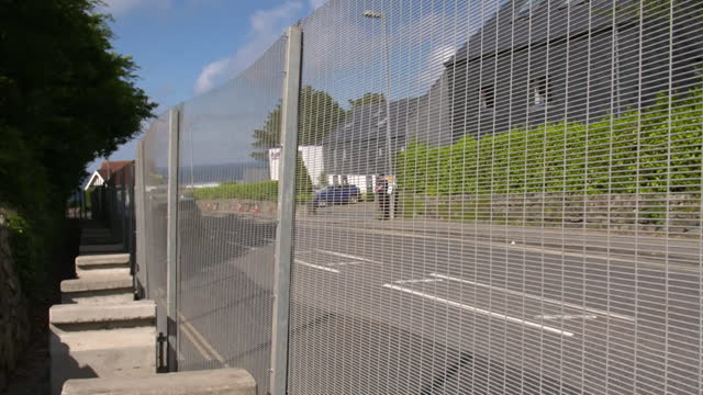 ring of steel placed around carbis bay, cornwall, as they prepare to host g7 summit, with military aircraft and ship patrols and metal fencing - boundary stock videos & royalty-free footage