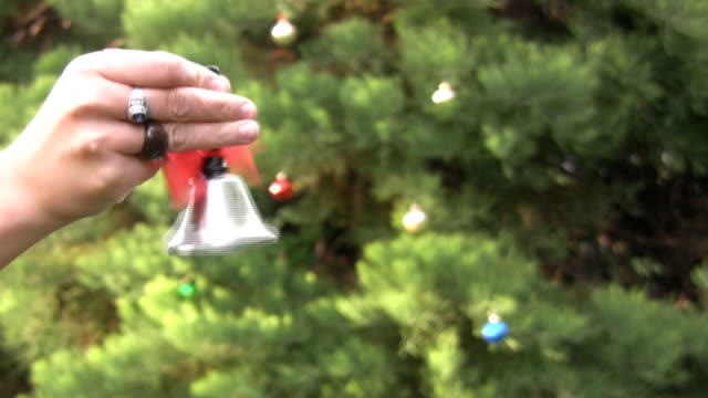 ringing a chrismas bell - ring stock videos and b-roll footage