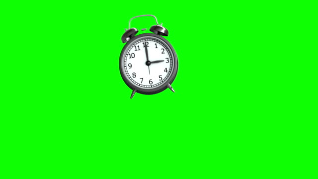 ringing and bouncing alarm clock. 3d animation. green background. loop animation - clock stock videos & royalty-free footage