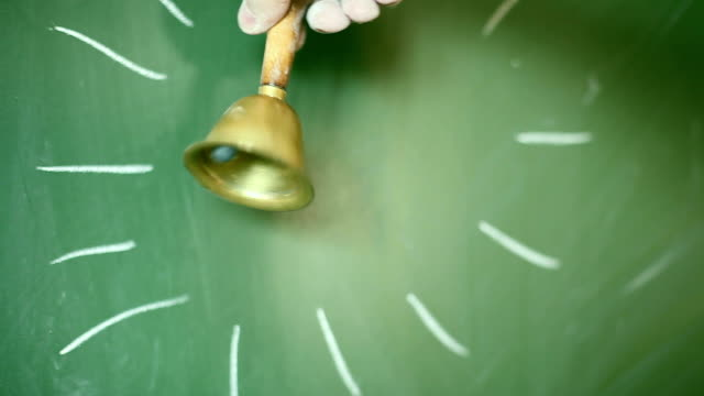 ringing handbell, green blackboard - school bell stock videos and b-roll footage