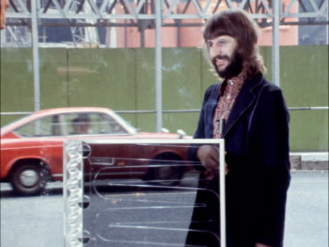 """ringo starr and kinetic art; england: london: sloane street: ext exhibit cms exhibit pull out to ringo starr interview sof: """"well that's what it... - ringo starr stock videos & royalty-free footage"""