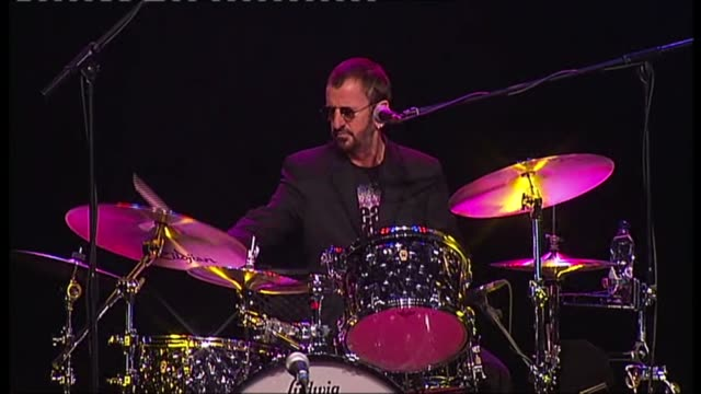 ringo starr exhibition at national gallery; r01061106 surrey: dunsfold park: ringo starr playing drums with his band - ringo starr stock videos & royalty-free footage