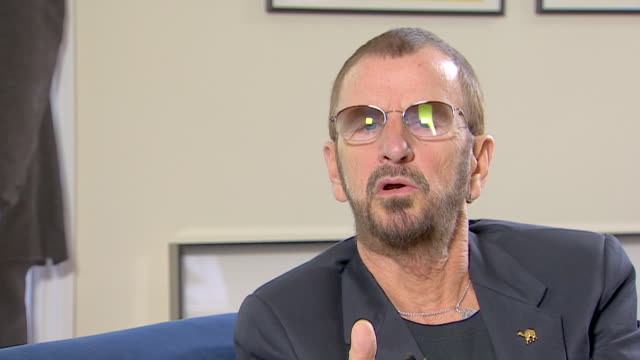vídeos de stock, filmes e b-roll de ringo starr on his career in the beatles saying 'we put all our energies into the beatles and then it started dissipatingand we wanted to do other... - 2013