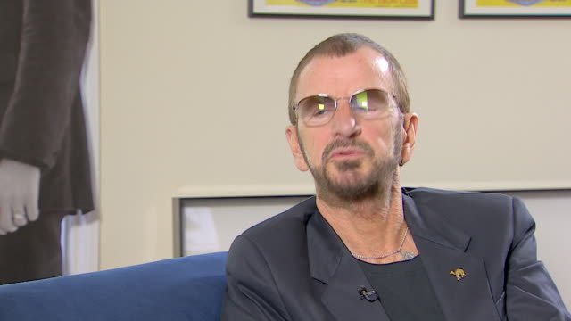vídeos de stock, filmes e b-roll de ringo starr talks about his charity work saying 'everything i do besides playmost things i do goes into the lotus foundation' - 2013