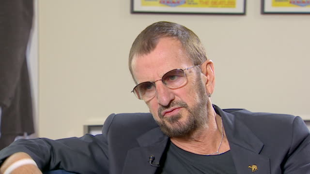 vídeos de stock, filmes e b-roll de ringo starr talks about his life prior to joining the beatles telling his family that 'i'm leaving the factory [as an apprentice engineer] and i'm... - 2013