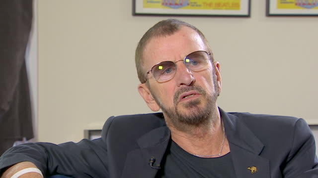 vídeos de stock, filmes e b-roll de ringo starr talks about his working class background saying 'there was not a lot of money at allwe were working class and then we became lower... - 2013