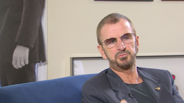 vídeos de stock, filmes e b-roll de ringo starr talks about joining the beatles saying 'i played the gig with the beatles because their drummer couldn't turn up for some reason or other' - 2013