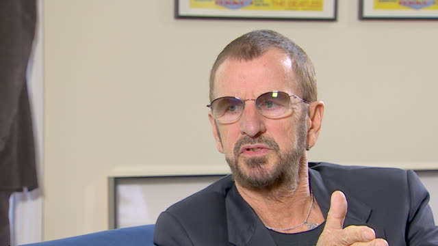 vídeos de stock, filmes e b-roll de ringo starr talks about the 'good memories' he has during his time with the beatles - 2013