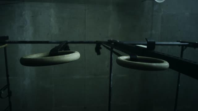 rings in gym - gymnastic rings stock videos & royalty-free footage
