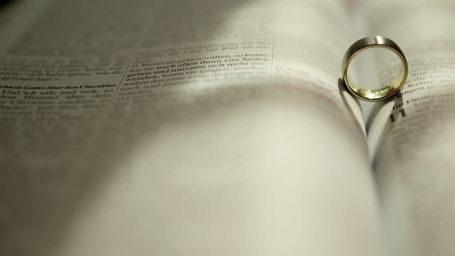 Rings on the Bible - Stock Footage