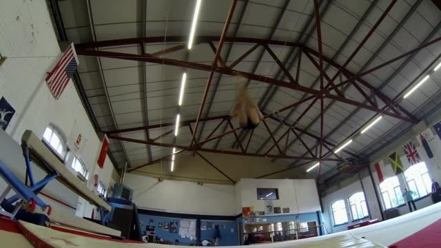 British gymnast Claudia Fragapane Somerset Bristol Low angle shot Fragapane performing somersaults on mat