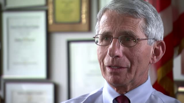Call for games to be moved or postponed because of the Zika virus USA Washington DC INT Reporter sat with Dr Anthony Fauci Low angle view of Fauci Dr...