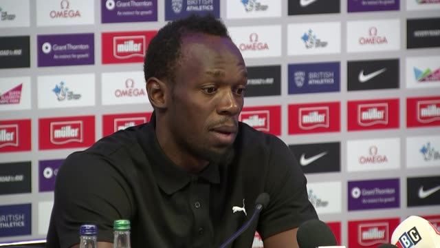 cas upholds ban on russian athletes england london ext usain bolt along outside hotel and posing photography** bolt at press conference usain bolt... - 記者会見点の映像素材/bロール