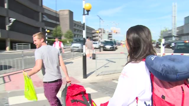 great britain team arrives home england manchester airport ext sam queck leaving airport and posing for photograph with young fan queck crossing road... - field hockey stock videos and b-roll footage