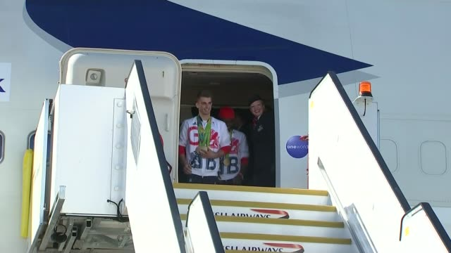 great britain team arrives home ext double olympic gold medal winning gymnast max whitlock and adams from aircratt and waving - olympic medal stock videos & royalty-free footage