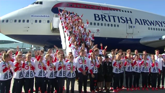 rio 2016 olympic games: great britain team arrives home; team gb waving from steps and on ground beneath plane for group photo - team photo stock videos & royalty-free footage