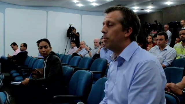 Olympic stadium closed due to rusty supports Rio de Janeiro Olympic press conference Officials at press conference desk Reporter asking question of...