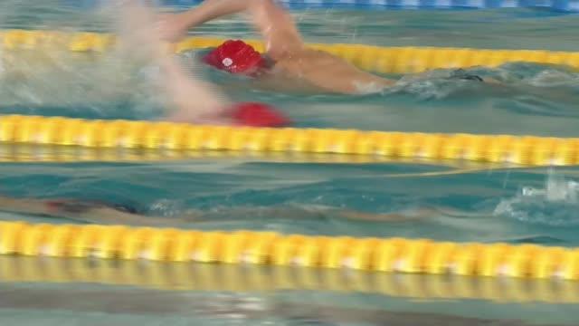vídeos de stock, filmes e b-roll de russian athletes await decisions on whether they can compete brazil belo horizonte int various of swimmers from team gb training in swimming pool rio... - rio russian