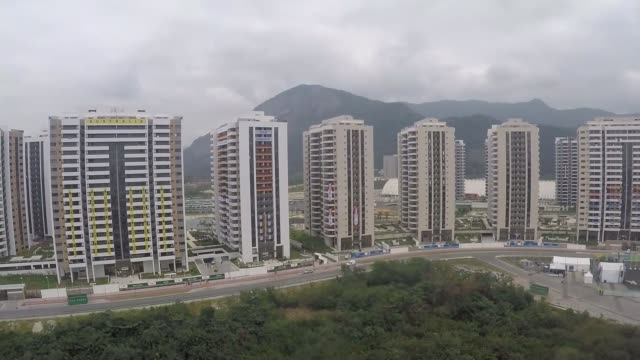 vídeos de stock, filmes e b-roll de russian athletes await decisions on whether they can compete air view / aerial blocks of flats forming the olympic village aleksei selivanenko... - rio russian
