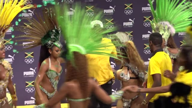usain bolt press conference **music heard sot** bolt being joined on stage by group of female samba dancers / bolt dancing with group of dancers /... - bolt stock videos & royalty-free footage