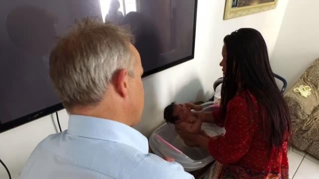 Victims complain at lack of help as prevention measures continue BRAZIL Rio de Janeiro INT Gleice de Souza bathing her baby daughter Barbara who...