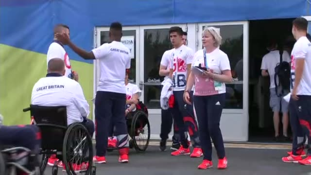 Great Britain flagbearer named BRAZIL Rio de Janeiro Lee Pearson interview SOT Great Britain Paralympians outside doors and pair playing table tennis...