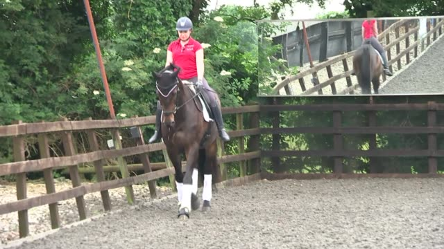 natasha baker interview england int natasha baker along with horse in stables baker riding horse - itv london lunchtime news点の映像素材/bロール