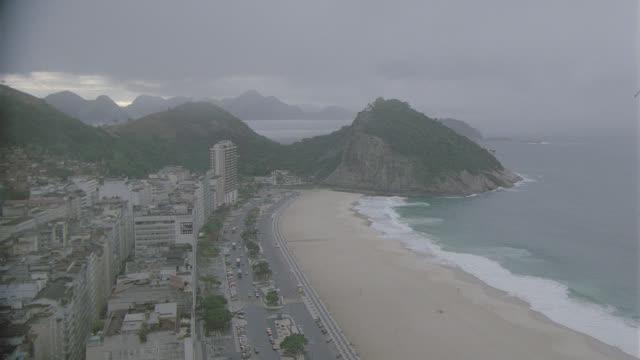 h-d rio de janeiro coastline, slow move in to beach - rio de janeiro stock-videos und b-roll-filmmaterial