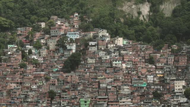 rio de janeiro 'rocinha' slum community landscape houses - リオデジャネイロ点の映像素材/bロール