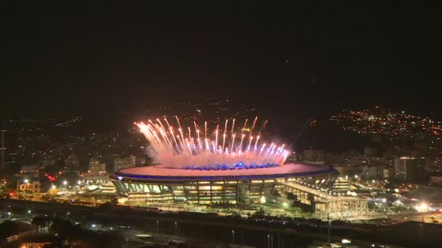 rio de janeiro's maracana stadium is showered with fireworks as the 2016 olympic games officially open - sport venue stock videos & royalty-free footage