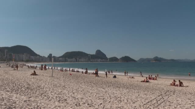 """rio de janeiro's residents find """"wise"""" the city's decision to cancel the annual new year's eve celebrations -- which traditionally see millions of... - number of people stock videos & royalty-free footage"""