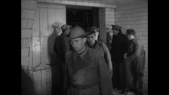 HA XWS Rio Tinto mine / Republican prisoners being used as miners walking out of building prisoners outdoors stacking mercury flasks onto tall...