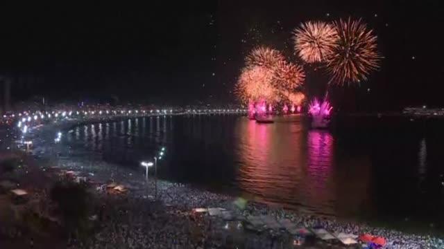 rio's copacabana beach celebrates the new year with fireworks - copacabana stock videos & royalty-free footage