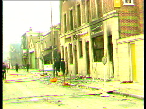 riot aftermath burnt out cars and buildings still smoking piles of rubble brixton riots; apr 81 - 1981 stock videos & royalty-free footage