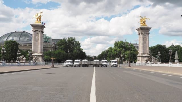 riot police are securing the area with anti riot barriers during a demonstration against racism and police brutality at pont alexandre iii in front... - pont alexandre iii stock videos & royalty-free footage