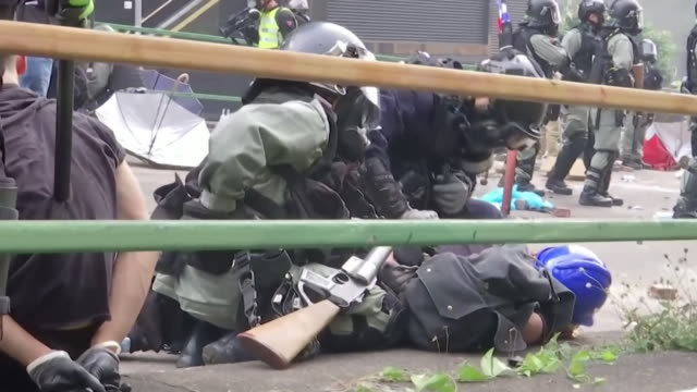 riot police arrest protesters who left the siege at the hong kong polytechnic university - demonstrant stock-videos und b-roll-filmmaterial
