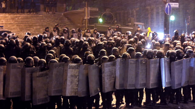 riot police at demonstration in kev - january 2014 - vox populi stock videos & royalty-free footage