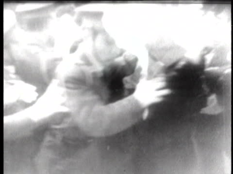 riot police attempt to control mobs of japanese students demonstrating against nuclear testing in the pacific. - pacific war stock-videos und b-roll-filmmaterial