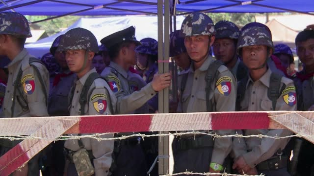 Riot police corral dozens of student protesters calling for education reform in central Myanmar