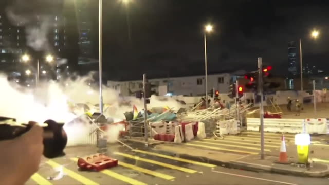 riot police fire tear gas at protestors outside the hong kong parliment building, legco, who are angry about the proposed extradition law - hong kong stock videos & royalty-free footage