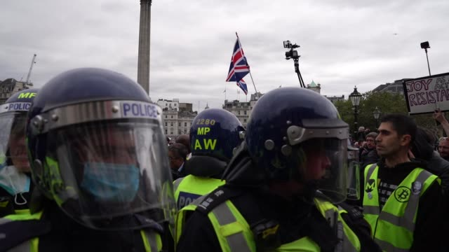 """riot police hold a line as protesters clash with police officers during a """"we do not consent"""" anti-lockdown rally at trafalgar square on september... - video stock videos & royalty-free footage"""